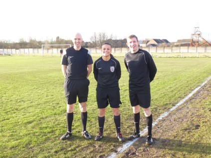 Today's referee, Lisa Rashid and her two assistants kindly pose for the camera. Much appreciated.