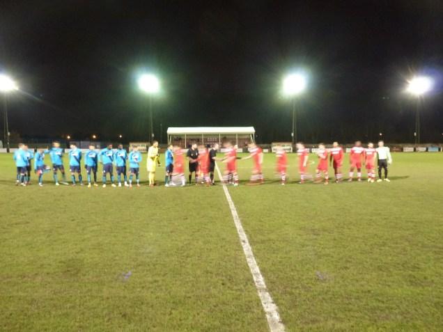 The customary handshake, then the match got under way.