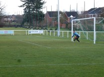 Brocton's goalkeeper braces himself for the penalty shot.. where drew Aiton scored.