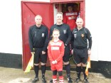 Match officials, Messrs Paul Wainman, James Kerrigan and Alan Thomas kindly pose with WWFC mascot Mollie Stretton before leading the players on to the field.