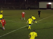 A clearance kick by Walsall Wood's goalkeeper being closely monitored
