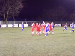 Walsall Wood players celebrate scoring the only goal of a workmanlike match