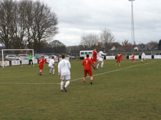Westfield forward and Walsall Wood defender rising to the challenge at the visitors challenge the Oak Park lads here