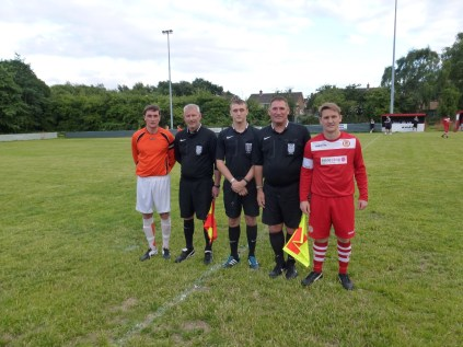 Walsall Wood played in red strip