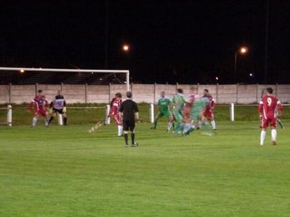 Alvechurch player falls in Alvechurch attack near Wood goal