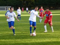 Two Coleshill players, about to lose the ball.