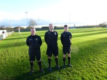 Today's referee, Mr Kuzmanovic with his assistants Messrs Pelech and Prescott