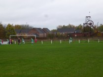 Corner to Brocton as Wood close ranks, and a nearby pigeon holds its breath.