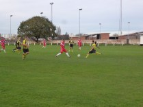Hollbeach start an attacking move as Wood challenge