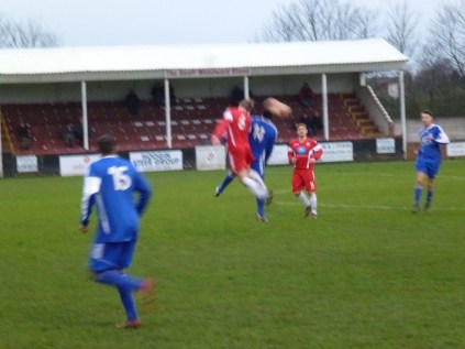 Leaping high for the ball.