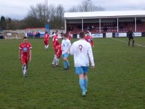 The referee blows his whistle to bring this thrilling match to an end and players shake hands.