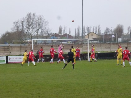 The gusting wind which bedevelled the game lifts a Shepshed snap-shot skyward