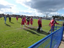 The players leave the ground after an enjoyable match to spectate where visiting fans were made welcome by club officials and home supporters.