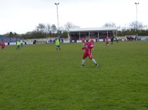A throw-in starts another attack by the Wood