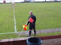 One drenched linesman looks for the final whistle.