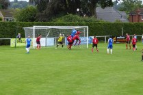 AFC Wulves defend their goal en masse as the Wood go airborne to try to score the equaliser. But not today.