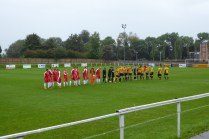 A cold miserable wet afternoon to greet the teams. The Wood played in red