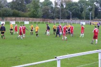 The sodden players shake hands at the end of this creditable soccer match and head to the warmth of the changing rooms