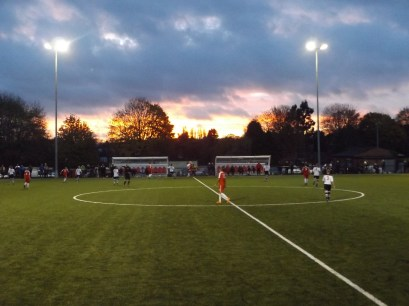 Dark clouds roll away to reveal bright late afternoon sunshine in the late quarter of the match