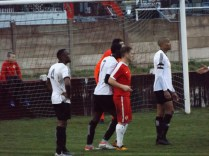 Corner kick to the Wood as Khalsa defenders prepare, in their own way