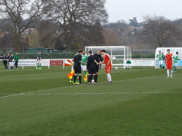 A meaningful display of football, and the only handshake until after the match. Brocton in pea green tops and white shorts, initially