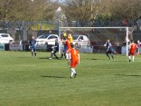 Long Eaton goalkeeper in action in an Alpine leap to catch the ball.