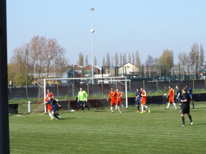 "The Wood adopt a ""chalet"" defence position as Long Eaton prepare to receive a high lobbed ball."