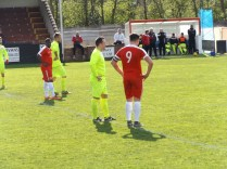 A brief moment of respite for the combatants as a player gets up from a tumble. Free kick awarded and the player makes a miraculous recovery.
