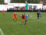 A sporting, rumbustious soccer match began in brilliant sunshine after the heavy rain.
