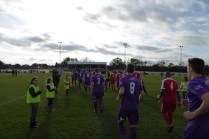The teams emerge, with HInkley sporting an all- purple strip. This is going to be a good, good match!