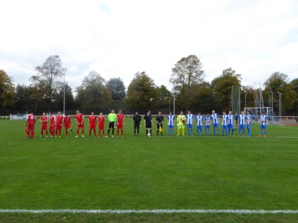 The Wood played in red. Nuneaton's goalkeeper played a superb match.