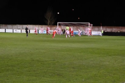 An incoming high corner kick brings full attention by Highgate as the Wood's composure brings rewards