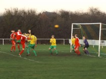 A terrific powerful header by no 10 scores the third goal to the Wood. First half still.