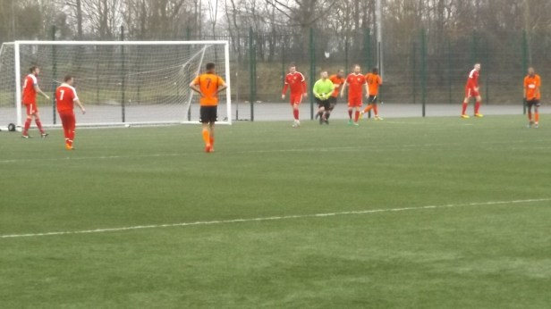 The Wood's guest goalkeeper for the day played a masterful game; seen here fending off a Pelsall attack.