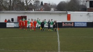 Two teams emerge from the warmth of the dressing rooms. Heavy playing surface to test both sides