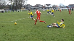 Later in the second half and one of a revitalised Wood's beautiful display of skill, weaving through, round and over . All the players would finish the game with their knees and shorts dirty this afternoon.