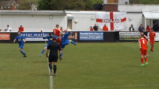 Leaping high for the ball. One of several delightful moments seen throughout the match
