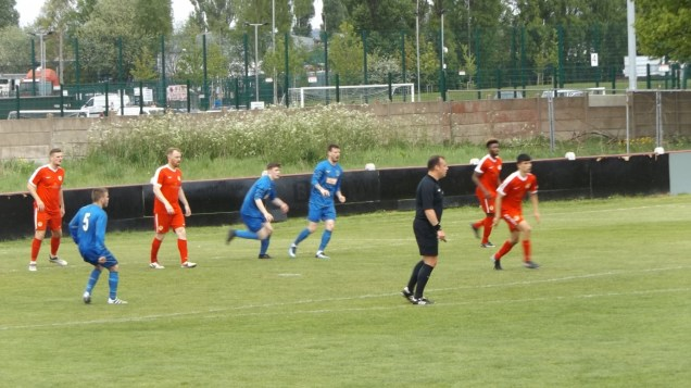 Bolehall, now numbering two more than when they kicked off, launch a determined attacking move. First half
