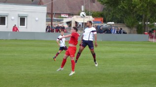 First half and two players leap for the ball, keeping a respectable distance. Of course