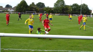 Later in the first half and Uttoxeter goalkeeper is again put to the test. Full marks for bravery