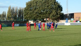 Quorn celebrate scoring their equalising goal, to odd criticism from one quarter in the away terrace.