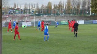 South Normanton respond with vigour and test the Wood goalkeeper to the limit. Ouch!