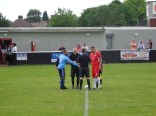 The two captains, and last season team colleagues, shake hands.