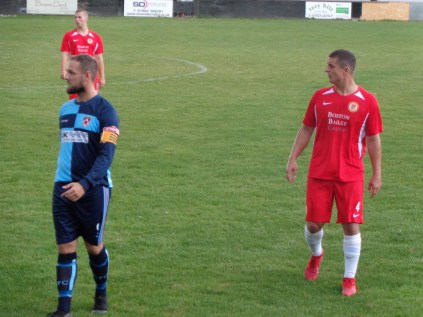 First half. Concentration as Gresley captain Sullivan observes, and takes in the strategy of the home side.