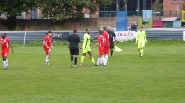 The match ends and the two captains shake hands as do some of the Wood players with some of their opponents.