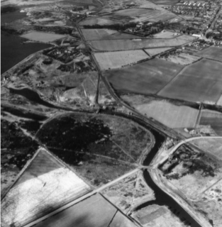 Anglesey basin and wharf, with Chasewater Dam top left.