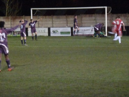 In the net, but just off-side. Much murmuring among the semi-frozen home supporters.