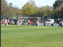 The Wood in full attack mode. This powerful header challenges Heanor's fine goalkeeper.