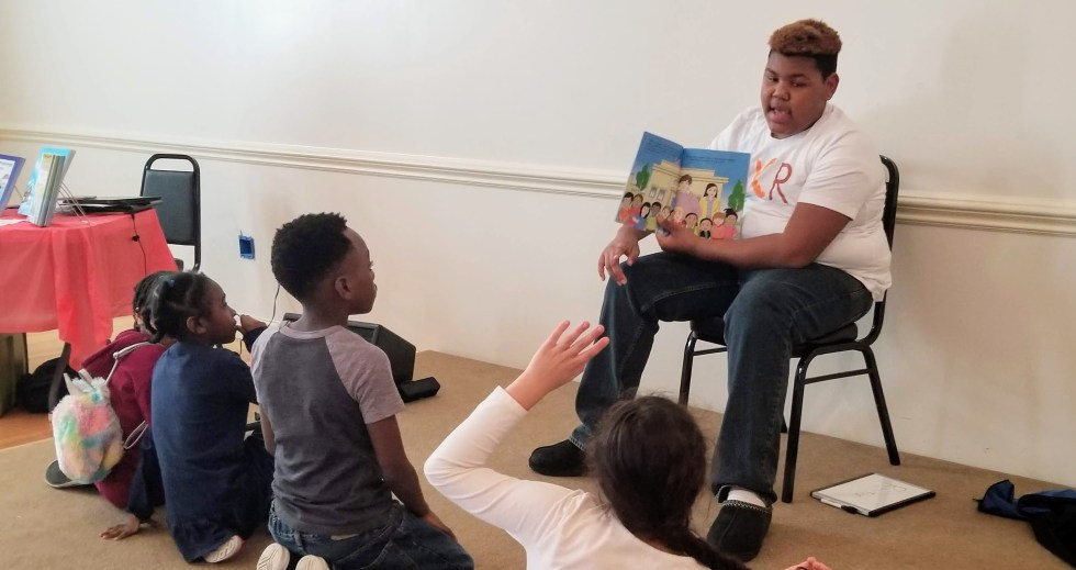 Storytime with a Teenage Volunteer at Brown Kids Read Event