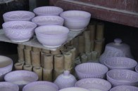 Decorated bowls before being fired in the ovens